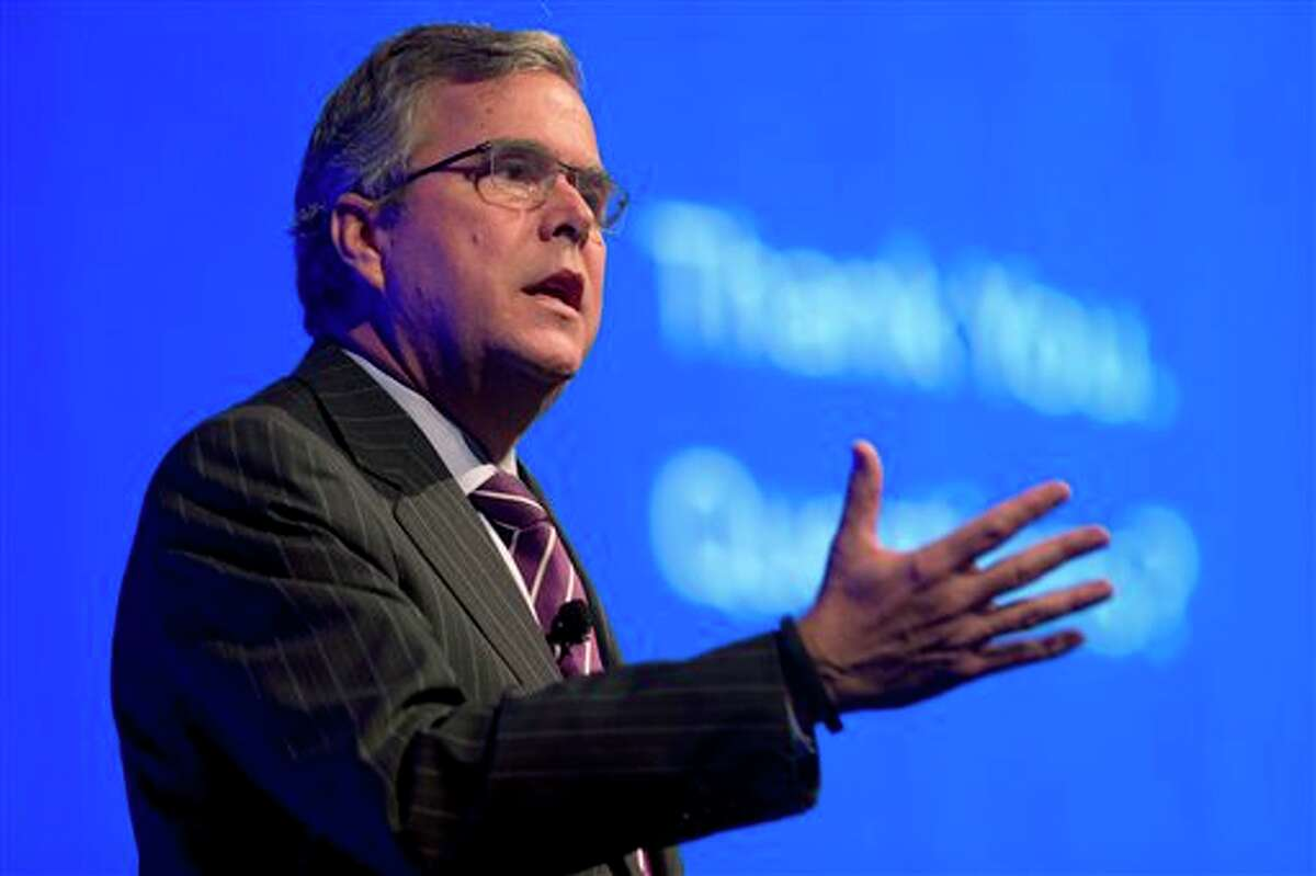 FILE - This Jan. 29, 2014 file photo shows former Florida Gov. Jeb Bush speaking in Hollywood, Fla. Will Jeb Bush run for president? The former Florida governor says he's undecided but his decision is one of the most significant unknowns looming over the 2016 Republican presidential contest. A White House bid by the scion of the Bush political dynasty would shake up a wide-open field and set up a showdown with the tea party movement. (AP Photo/Wilfredo Lee, File)
