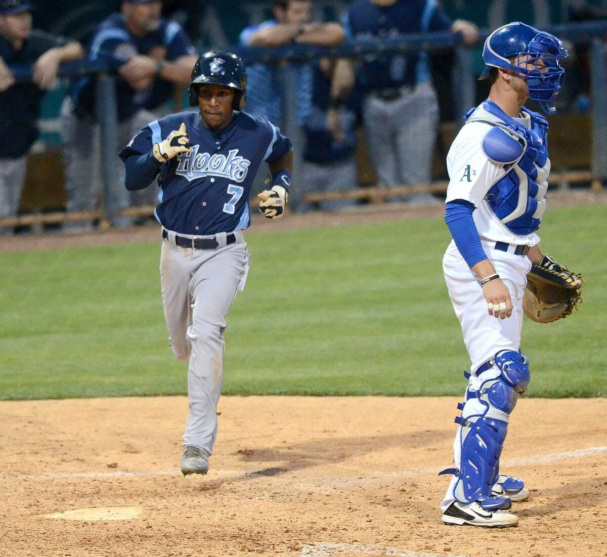 Corpus Christi's Tony Kemp tags home to score against the Rockhounds on Tuesday, June 9, 2015, at Security Bank Ballpark. James Durbin/Reporter-Telegram