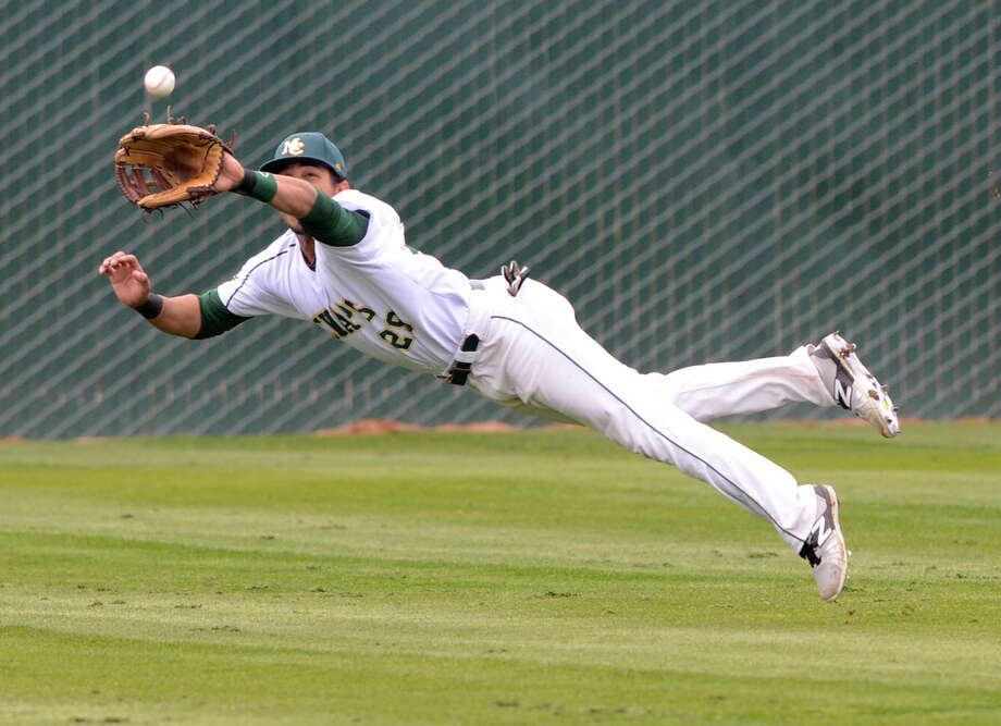 Midland College's Christian Whigham makes a diving catch for an out against Luna College on Friday, March 20, 2015, at Christensen Stadium. James Durbin/Reporter-Telegram Photo: James Durbin