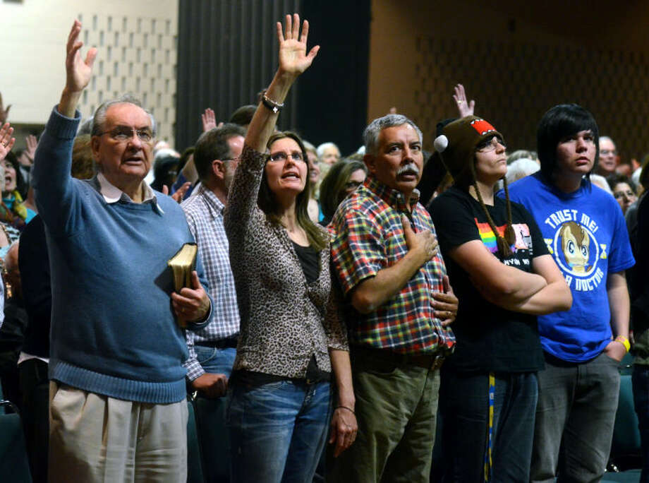 Attendees worship during the AWAKE 7:14 Prayer Revival last year at the Midland Center. James Durbin/Reporter-Telegram Photo: JAMES DURBIN