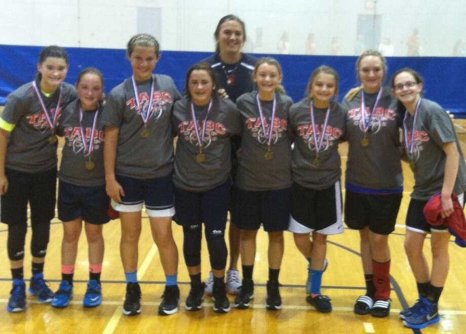 A team of James R. Brooks Middle School students won the WNBA Division at the Texas Association of Basketball Coaches Camp of Champs in Georgetown on Tuesday.  The players (pictured left to right) are: Kaitlan Keel, Ellee Franklin, Karly Savage, Kensliegh Ellis, Hunter Russell, Bradi Good, Jenna Swopes, and Mattie Huber. The camp coach (in back) was Diane Konarik from Salado. Photo: Courtesy Photo