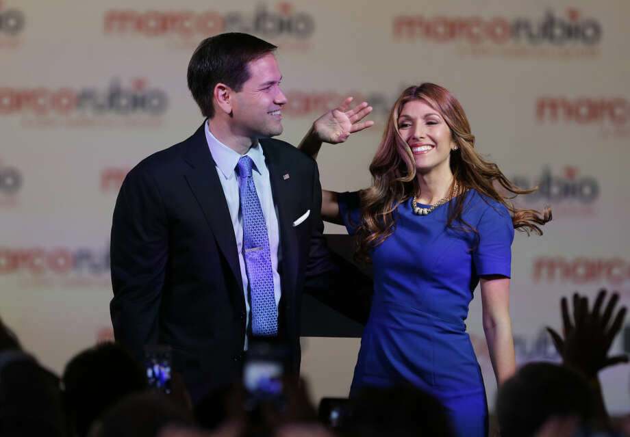 "In this photo taken April 13, 2015, Sen. Marco Rubio, R-Fla., and his wife Jeanette acknowledge the crowd after he announced that he will be running for the Republican presidential nomination, in Miami. During Rubio's first year in the Florida legislature, the 29-year-old lawmaker filled out the required forms detailing his personal finances. On the line listing his net worth, Rubio wrote: ""0."" Fourteen years later, after rising to lead the Florida House as speaker, winning election to the U.S. Senate and earning at least $4.5 million since 2001 at a series of six-figure jobs and by writing a best-selling memoir, Rubio has seen his net worth improve only modestly. (AP Photo/Wilfredo Lee) Photo: Wilfredo Lee"