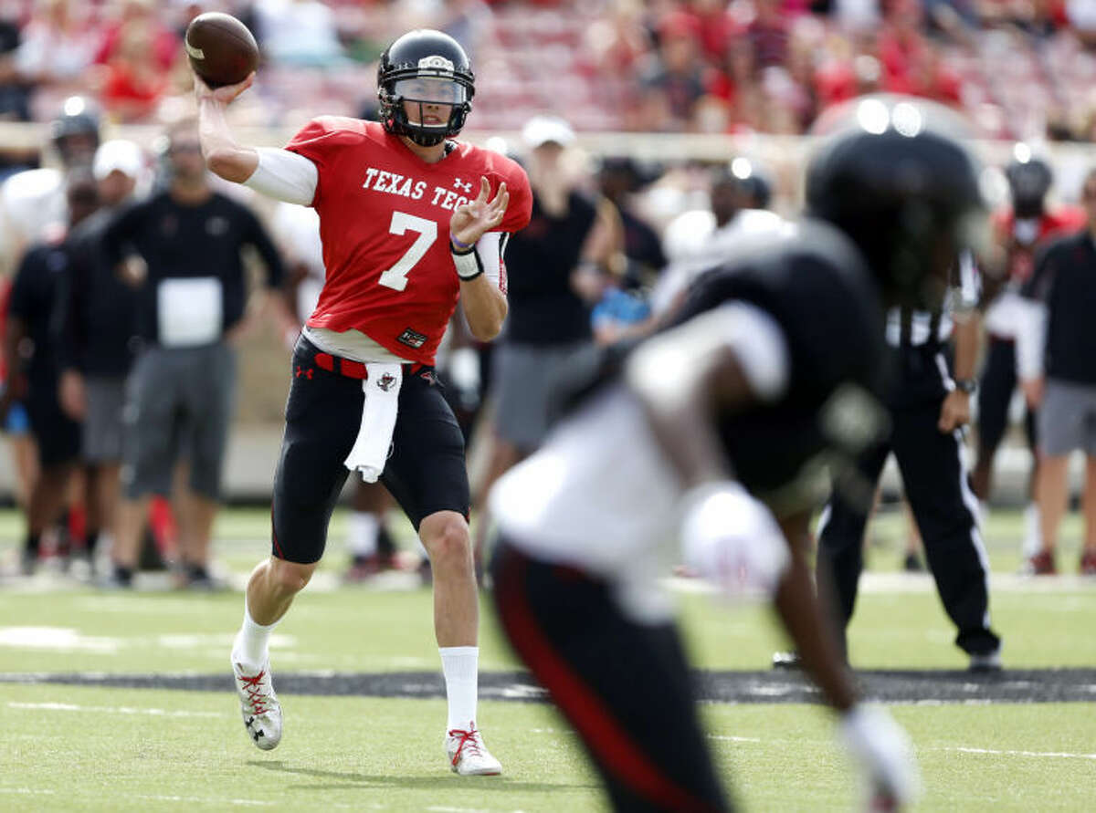 Texas Tech's Davis Webb (7) throws a pass during a spring NCAA college football game Saturday, April 12, 2014, in Lubbock, Texas. (AP Photo/The Avalanche-Journal, Tori Eichberger)