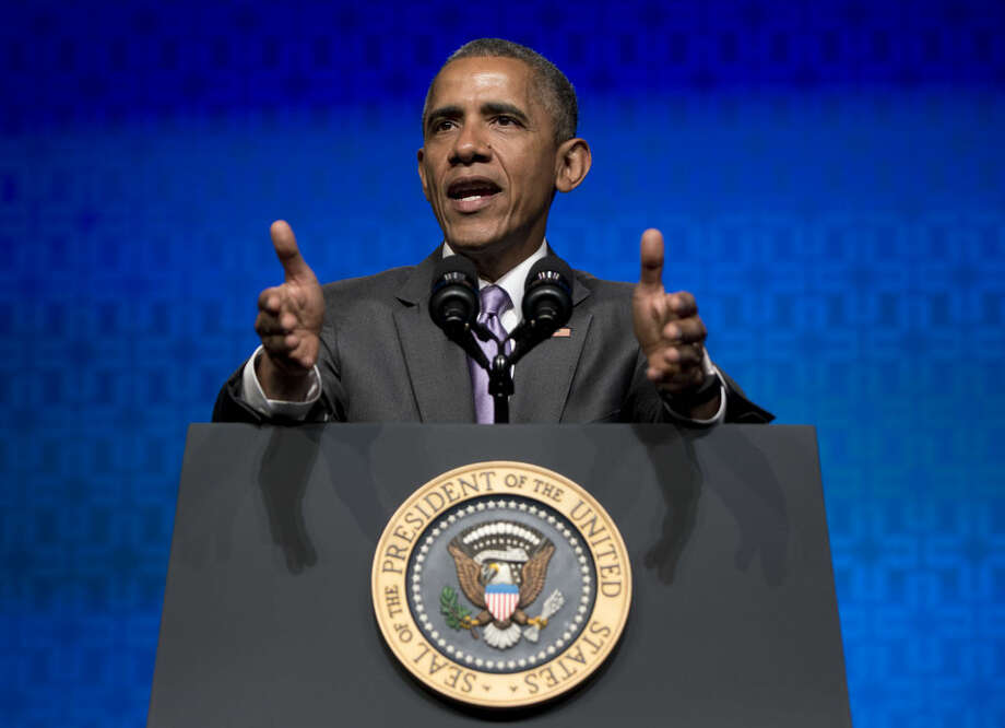 "President Barack Obama gestures as he speaks to the Catholic Hospital Association Conference at the Washington Marriott Wardman Park in Washington, Tuesday, June 9, 2015. Obama declared that his 5-year-old health care law is firmly established as the ""reality"" of health care in America, even as he awaits a Supreme Court ruling that could undermine it. (AP Photo/Carolyn Kaster) Photo: Carolyn Kaster"