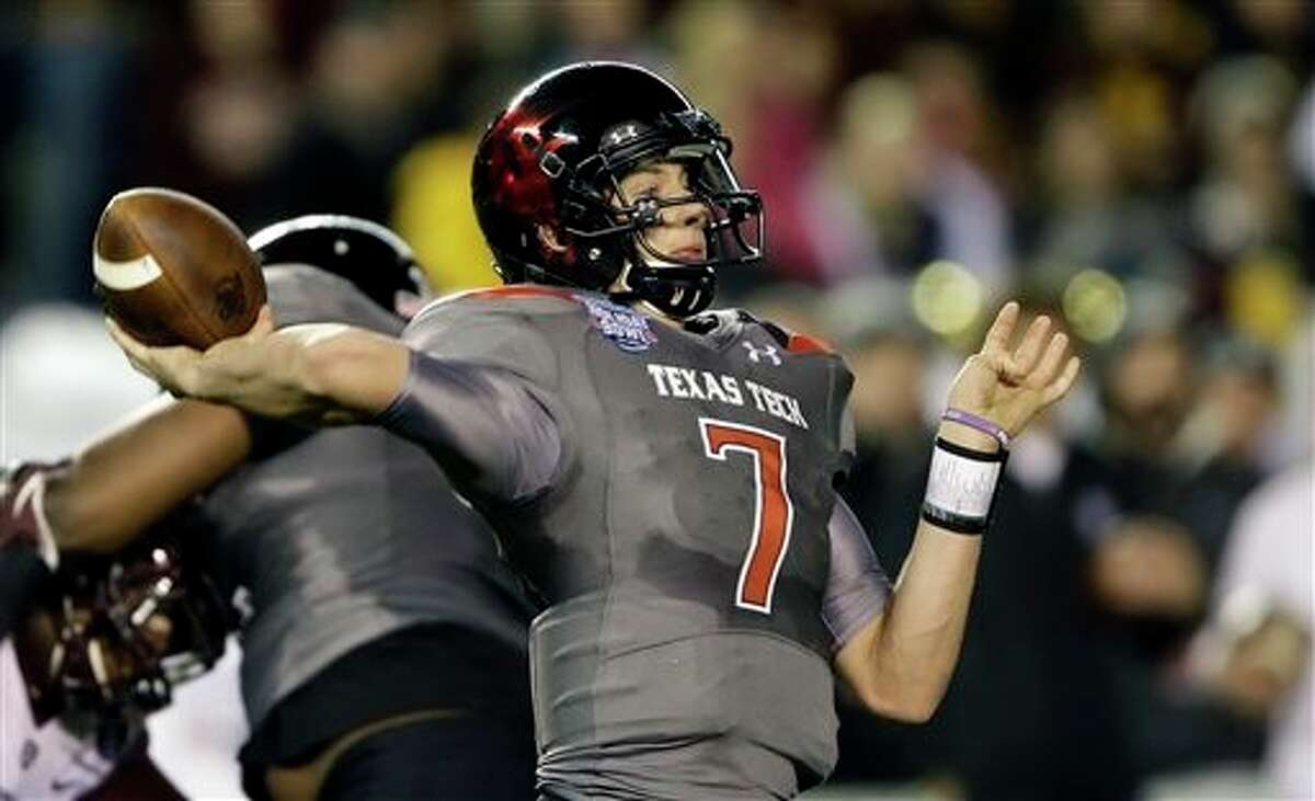 Texas Tech quarterback Davis Webb throws a long pass against Arizona State during the first half of the Holiday Bowl NCAA college football game, Monday, Dec. 30, 2013, in San Diego. Webb has thrown four touchdown passes in the first half. (AP Photo/Lenny Ignelzi)