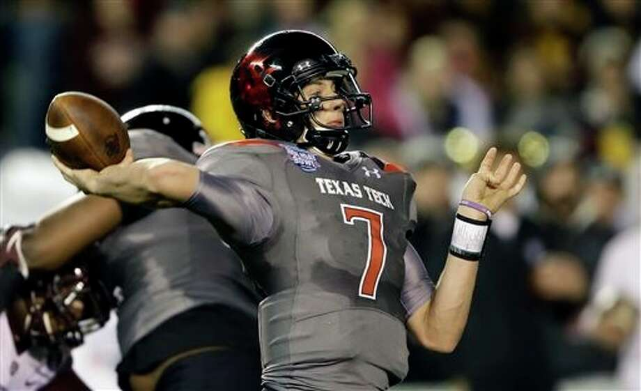 Texas Tech quarterback Davis Webb throws a long pass against Arizona State during the first half of the Holiday Bowl NCAA college football game, Monday, Dec. 30, 2013, in San Diego. Webb has thrown four touchdown passes in the first half. (AP Photo/Lenny Ignelzi) Photo: Lenny Ignelzi / AP