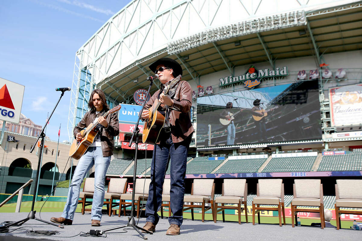 11/11/13: From left to right, Zach Gonzales and Tracy Byrd perform at the Veterans Day -November 11, 2013, Salute to Veterans at Minute Maid Park in Houston, Texas. Byrd will be performing in Midland on Saturday.