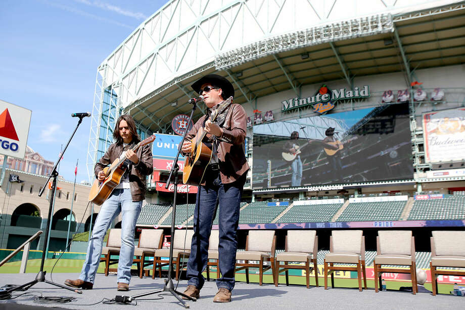 11/11/13: From left to right, Zach Gonzales and Tracy Byrd perform at the Veterans Day -November 11, 2013, Salute to Veterans at Minute Maid Park in Houston, Texas. Byrd will be performing in Midland on Saturday. Photo: Thomas B. Shea
