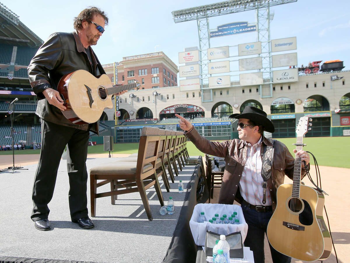 11/11/13: Singer Gary Morris talks with singer Tracy Byrd backstage at the Veterans Day -Novemeber 11, 2013, Salute to Veterans at Minute Maid Park in Houston, Texas. Byrd will be performing in Midland on Saturday.