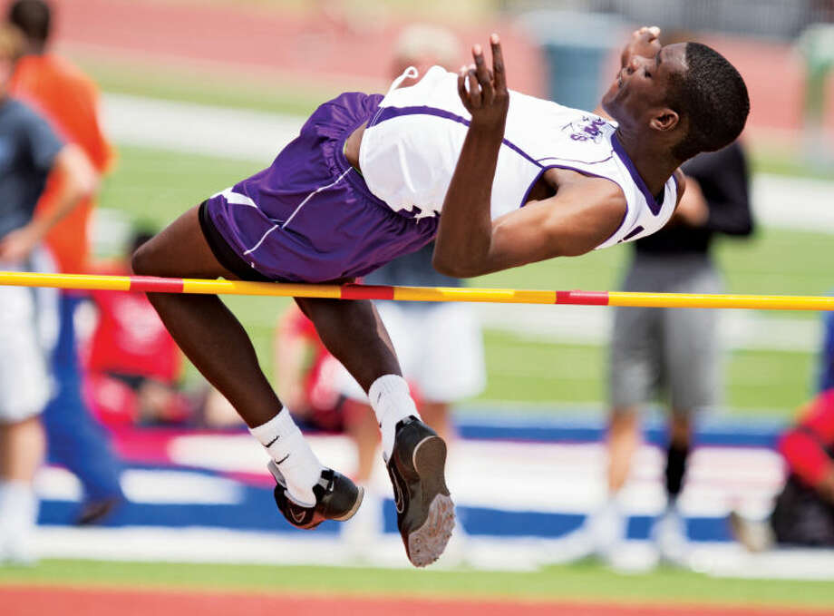 Midland High's Jumel Jones high jumps over the 6-foot bar during the UIL District 2-5A Track Championship on Friday at Lowrey Field in Lubbock. Jones finished fourth in the event after clearing the 6-02 bar. Photo: Brad Tollefson
