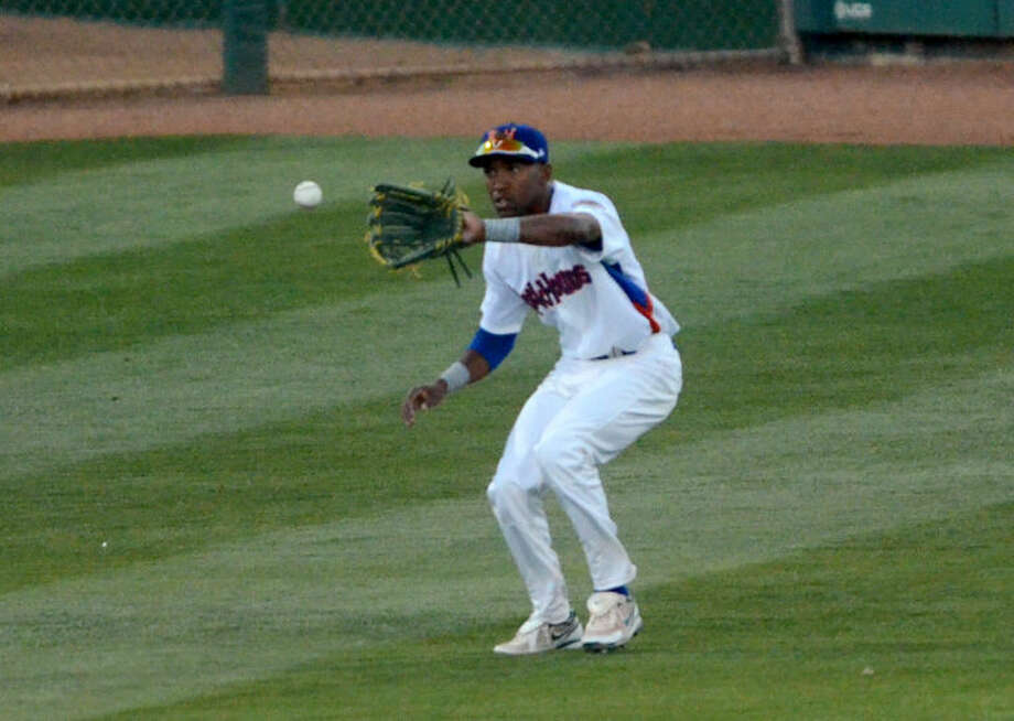 Rockhounds' D'Arby Myers fields the ball during the game against the Arkansas Travelers on Thursday at Security Bank Ballpark. James Durbin/Reporter-Telegram Photo: James Durbin