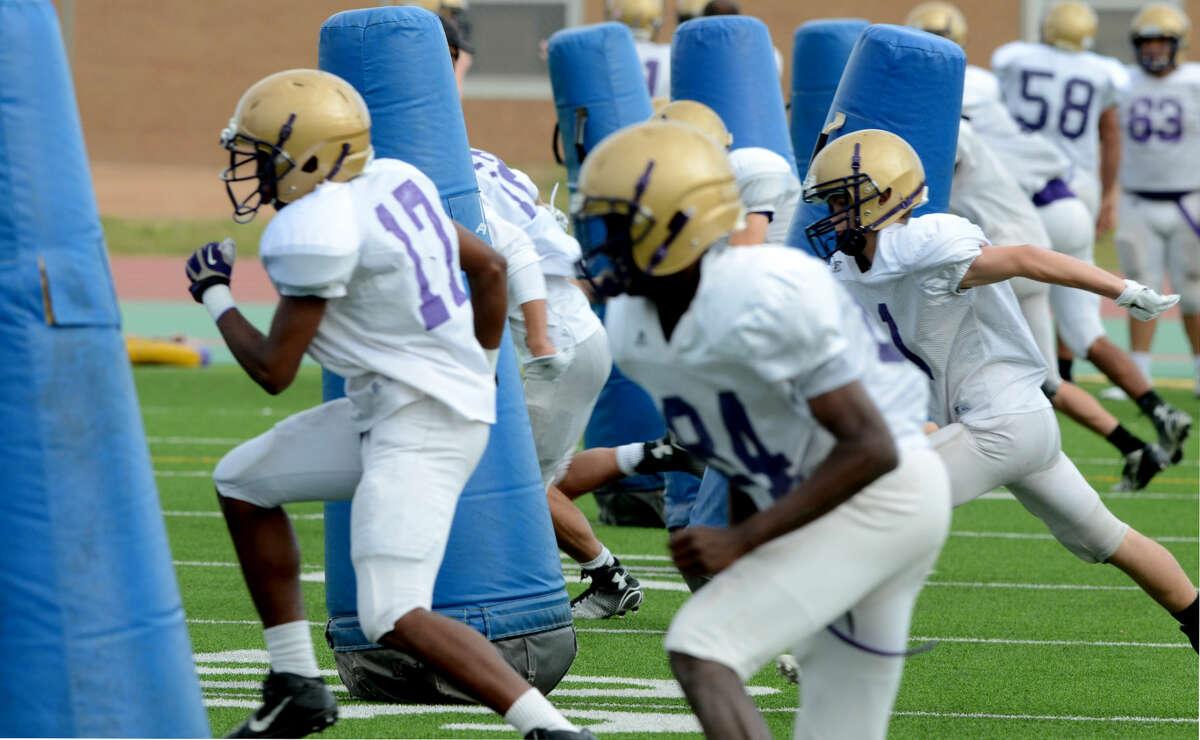 Midland High spring practice Tuesday, April 28, 2015, at Memorial Stadium. James Durbin/Reporter-Telegram
