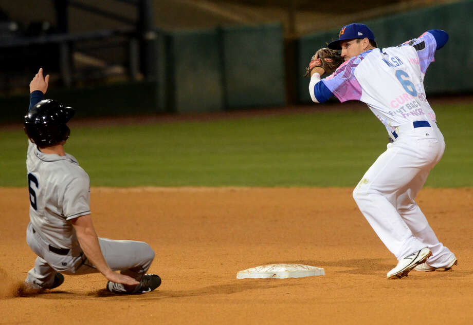 Rockhounds' Colin Walsh turns for a double play over Corpus Christi's Jon Kemmer on Friday, June 12, 2015 at Security Bank Ballpark. James Durbin/Reporter-Telegram Photo: James Durbin