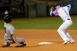Rockhounds' Colin Walsh turns for a double play over Corpus Christi's Jon Kemmer on Friday, June 12, 2015 at Security Bank Ballpark. James Durbin/Reporter-Telegram