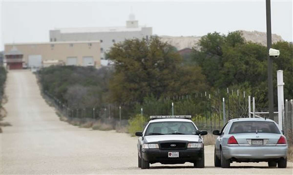 Texas Department of Public Safety cars idle along a road on the Yearning for Zion Ranch, Thursday, April 17, 2014, near Eldorado, Texas. State agents have seized the property, which belonged to the Fundamentalist Church of Jesus Christ of Latter Day Saints, and was where hundreds of children were removed during a 2008 FBI raid prompted by child sex abuse allegations. The group's leader, Warren Jeffs, is serving life in prison after being convicted of sexually assaulting two girls he took as child brides. The state sought to seize the property over allegations of mismanagement by Jeffs. (AP Photo/San Angelo Standard-Times, Jennifer Rios)