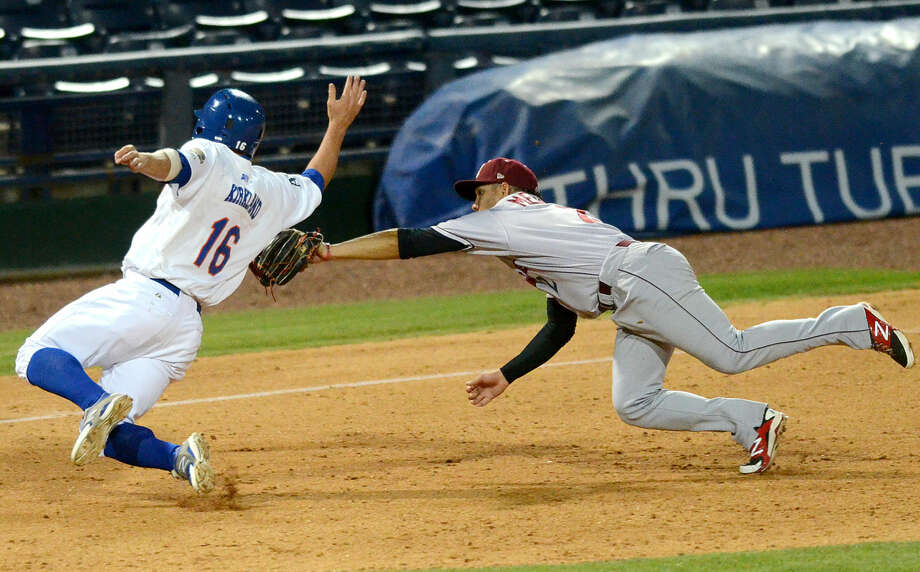 Rockhounds' Wade Kirkland slides into third base as Frisco's Luis Mendez chases him down for the tag while fielding a base hit from Josh Whitaker (not pictured) on Tuesday, June 16, 2015 at Security Bank Ballpark. James Durbin/Reporter-Telegram Photo: James Durbin