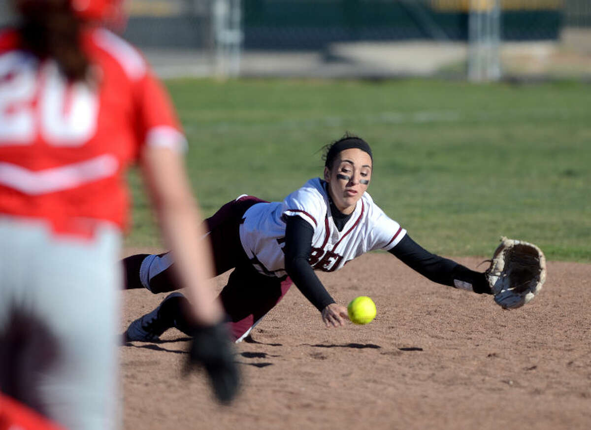 Lee High's Ciara Sheppard (5) dives for the ball during the game against Lubbock Coronado on Tuesday at Gene Smith Field. James Durbin/Reporter-Telegram