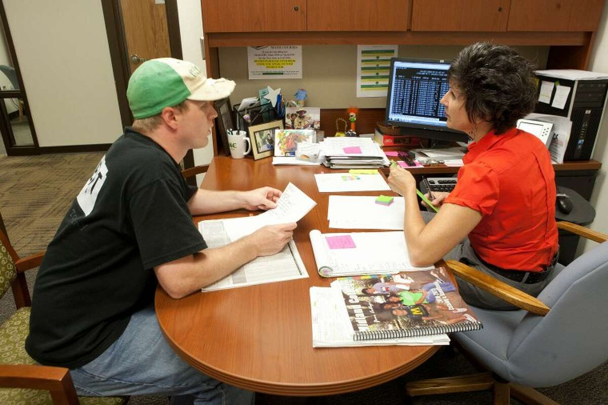 In this 2010 MRT file photo, Mary Allbright assists Jeremy Wood in picking classes that will work with his work schedule and will count as credit towards his computer science degree during registration at Midland College. Cindeka Nealy/Reporter-Telegram