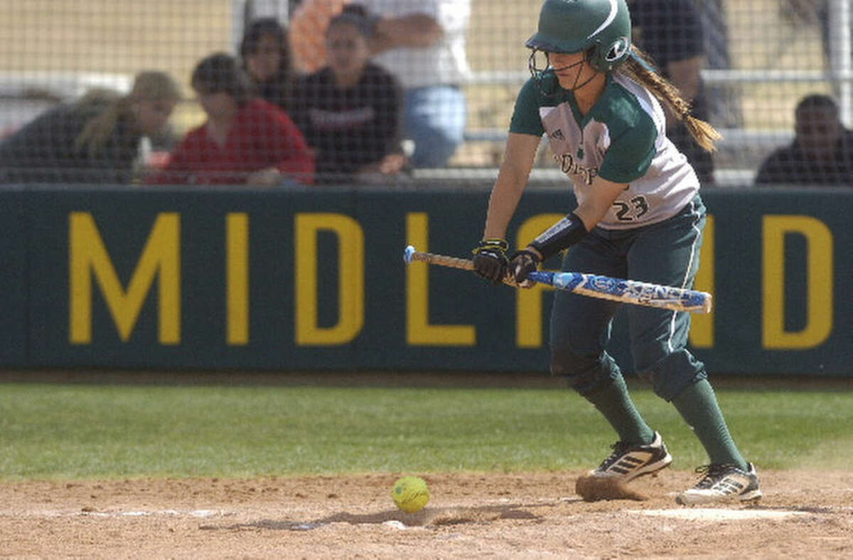 Midland College's Gaby Muniz (23) puts the ball in play on a bunt during the second game of a doubleheader against Howard College on Saturday. James Durbin/Reporter-Telegram