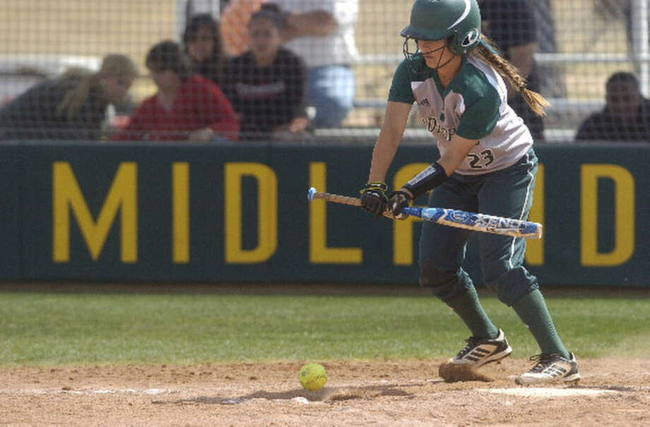 Midland College's Gaby Muniz (23) puts the ball in play on a bunt during the second game of a doubleheader against Howard College on Saturday. James Durbin/Reporter-Telegram Photo: James Durbin