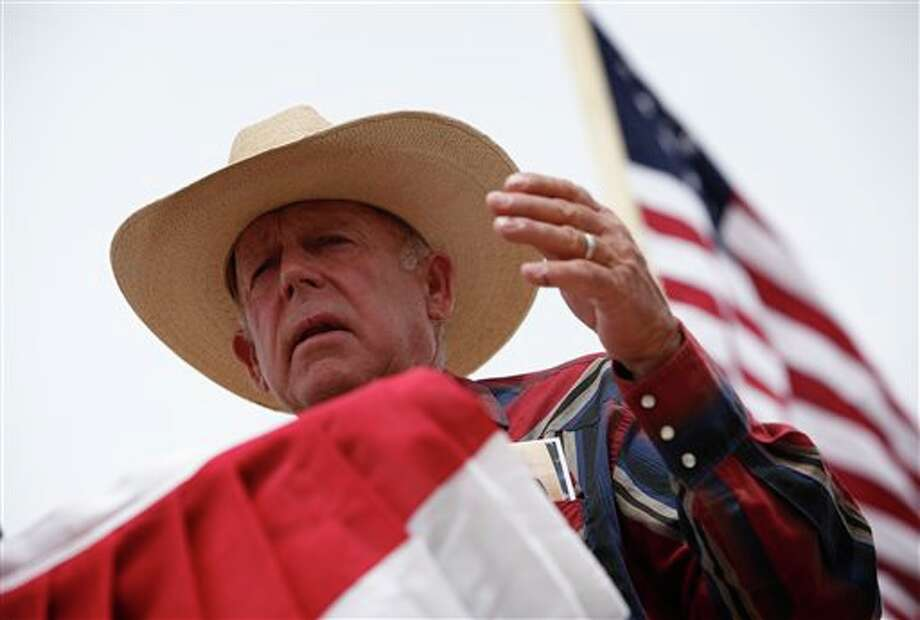 Rancher Cliven Bundy speaks at a protest camp near Bunkerville, Nev. Friday, April 18, 2014. (AP Photo/Las Vegas Review-Journal, John Locher) Photo: John Locher / Las Vegas Review-Journal