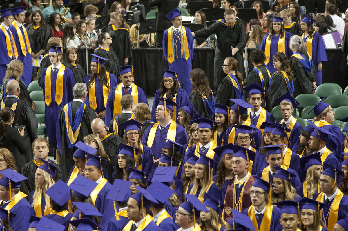 Midland High seniors process in Saturday, 5-30-15, at the commencement ceremony at the Midland College Chaparral Center. Tim Fischer\Reporter-Telegram