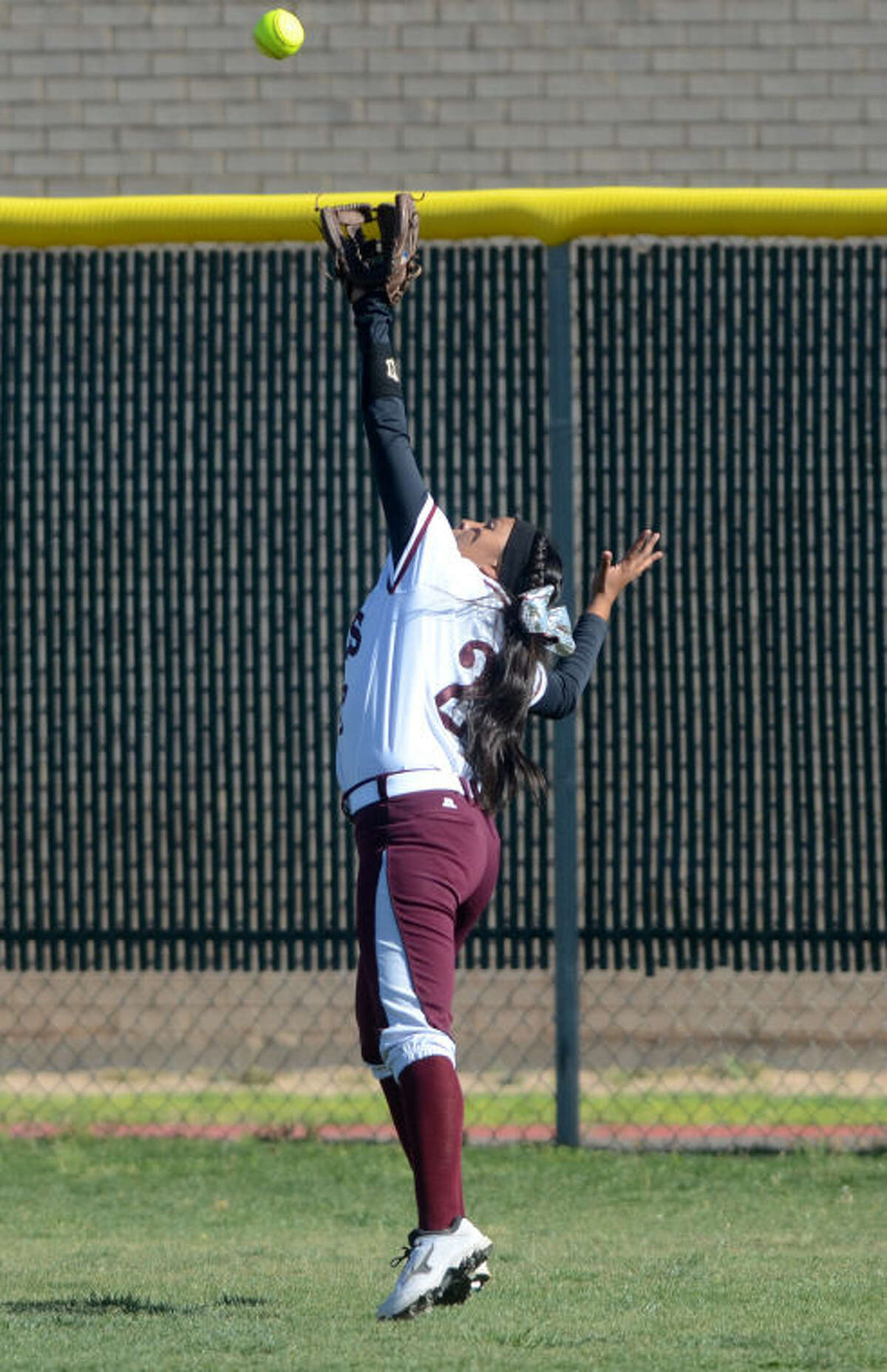Lee High's Emily Nunez (2) tries to make a catch in the outfield against Lubbock Coronado on April 15 at Gene Smith Field. James Durbin/Reporter-Telegram