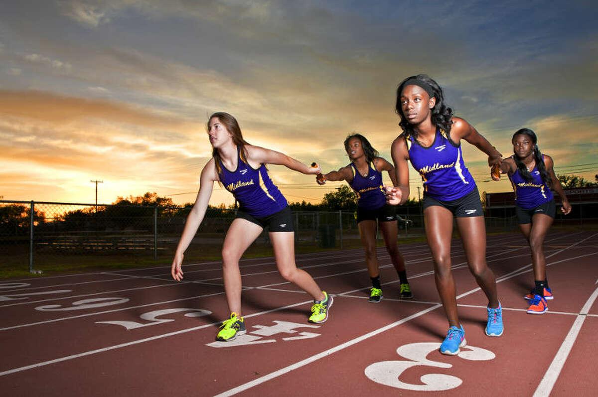 Midland High girls 800-meter relay team in portrait Wednesday at Memorial Stadium. Members are Tammie Hickey, Keaton Fricker, Jimmiriyia Goodley, and Bria Lewis. James Durbin/Reporter-Telegram