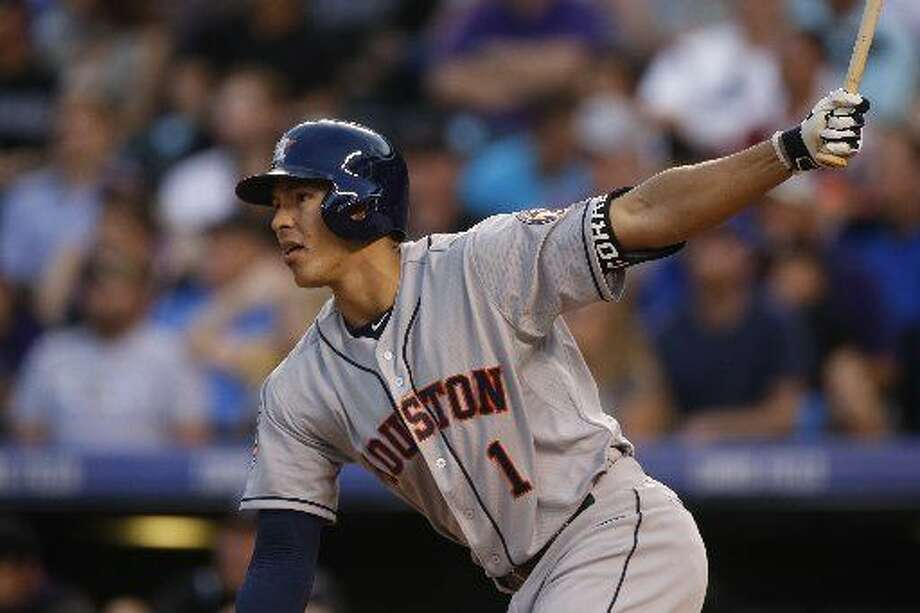 Houston Astros shortstop Carlos Correa bats against the Colorado Rockies during the fourth inning of an interleague baseball game Wednesday, June 17, 2015, in Denver. (AP Photo/David Zalubowski) Photo: David Zalubowski