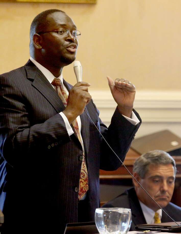 In this June 3, 2014 photo, state Sen. Clementa Pinckney speaks at the South Carolina Statehouse in Columbia, S.C. Pinckney was killed, Wednesday, June 17, 2015, in a shooting at an historic black church in Charleston, S.C. The shooter is still at large. (Grace Beahm/The Post and Courier via AP) Photo: Grace Beahm