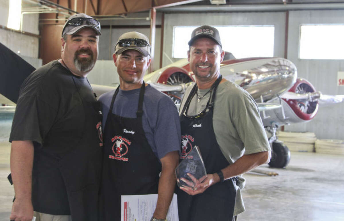 From left: Mark Hamilton Jr., Randy Ransom and Rick Johnson were awarded the Grand Champion award for their meat entries in the Best of the Basin barbecue competition held Friday and Saturday at the Commemorative Air Force. Tyler White/Reporter-Telegram