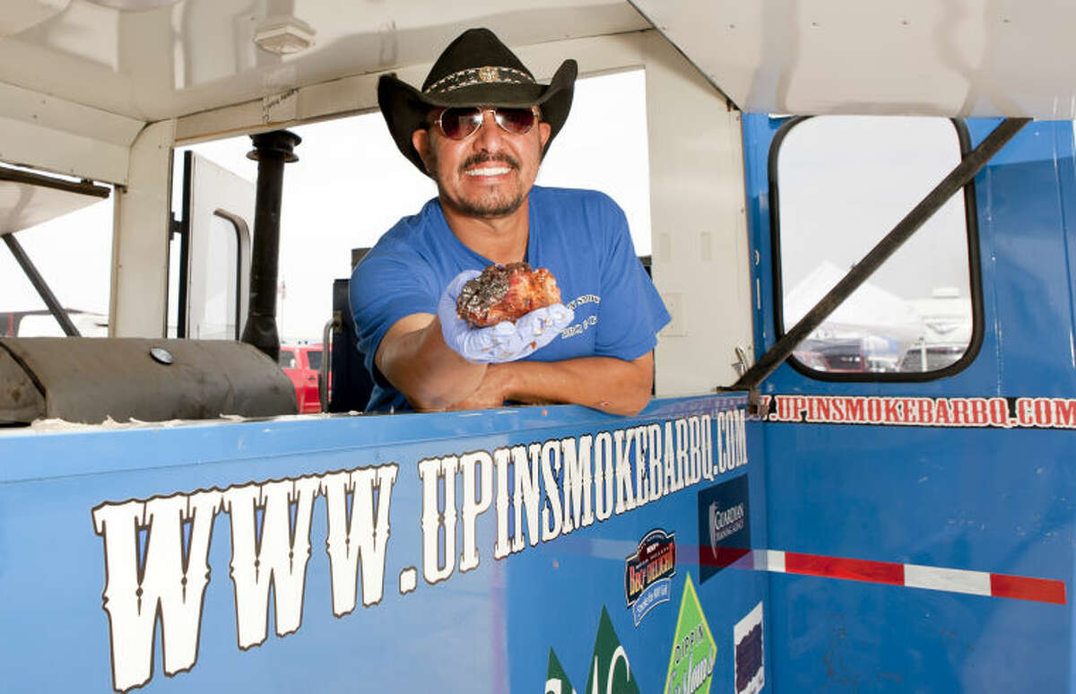 Junior Urias of Up In Smoke BBQ in Midland poses for a photo at the Best of the Basin BBQ Championship on Saturday at the CAF. James Durbin/Reporter-Telegram