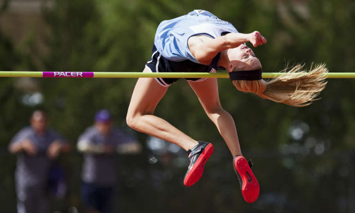 Midland Greenwood's Morgan McKee tries to jump over the 6' 09