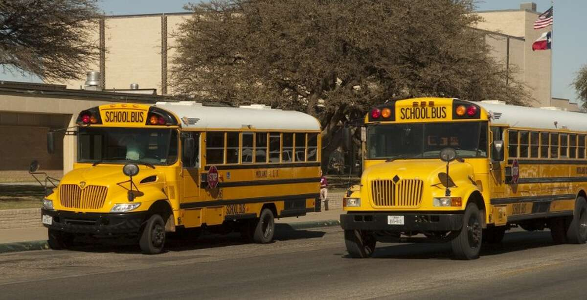 In this file photo, MISD school buses are parked in front of Lee High School. Photo by Tim Fischer/Midland Reporter-Telegram