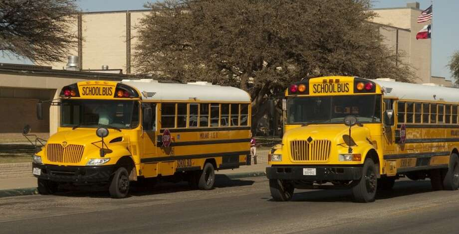 In this file photo, MISD school buses are parked in front of Lee High School. Photo by Tim Fischer/Midland Reporter-Telegram Photo: Tim Fischer