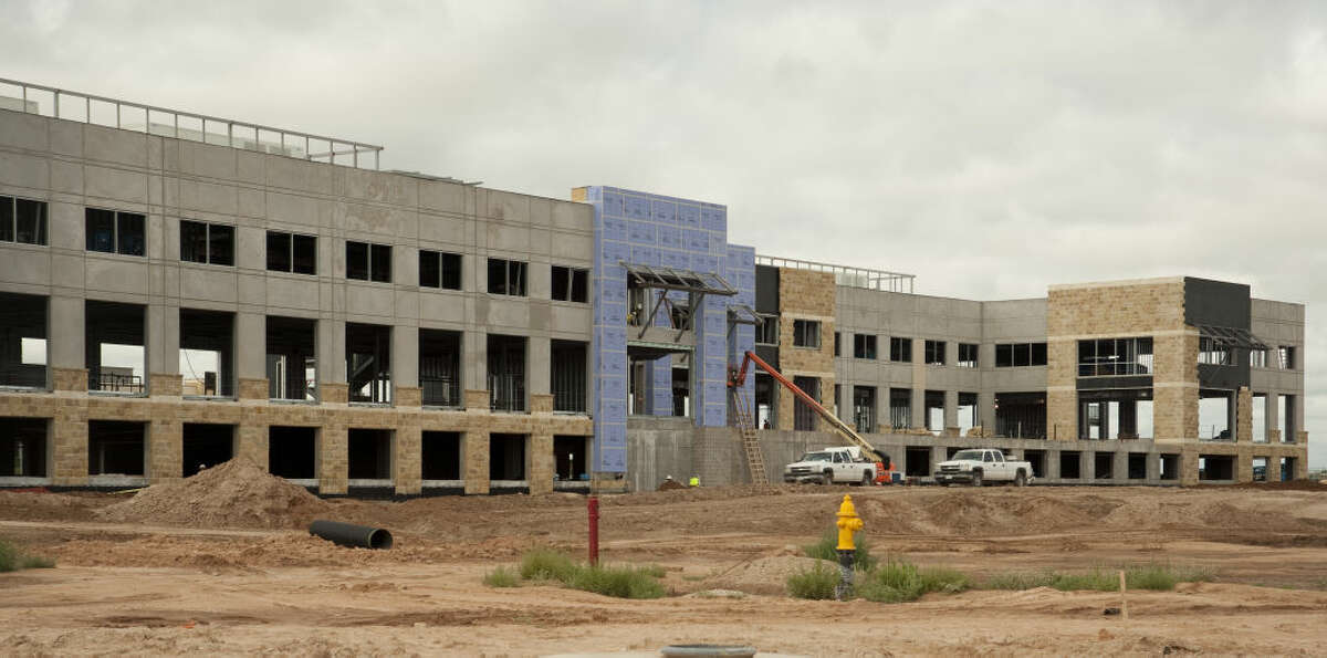 Work continues Wednesday, 6-17-15, on a new office building in Fasken Oil and Ranch Vineyard development. Tim Fischer\Reporter-Telegram