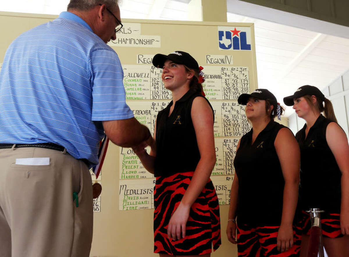 Andrews Libby Walinder accepts her state championship medal during the second and final day of the Class 3A State Golf Championships Tuesday at the Hyatt Resort Lost Pines Golf Course.