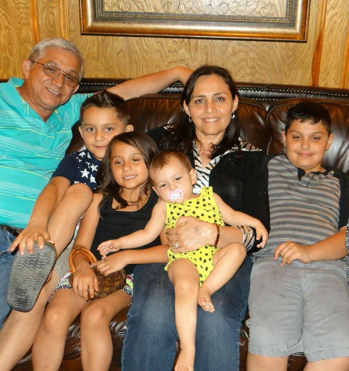 Deacon Luis Mata Sr., left, and his wife, Bertha Mata, with their grandchildren, Kalvin Mata, from left, Kalissa Mata, Ellie Mata, Bertha Mata, Keaten Mata.