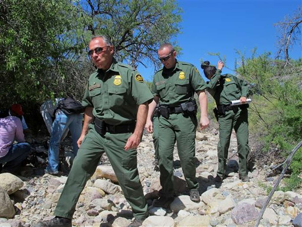 U.S. Border Patrol Tucson Sector Chief Manuel Padilla, left front, walks with other agents and media during a tour in the Buenos Aires National Wildlife Refuge, Wednesday, April 30, 2014, near Sasabe, Ariz. Padilla and other Border Patrol officials spent the day discussing the dangers for immigrants trying to cross the border illegally from Mexico into the U.S. (AP Photo/Brian Skoloff)