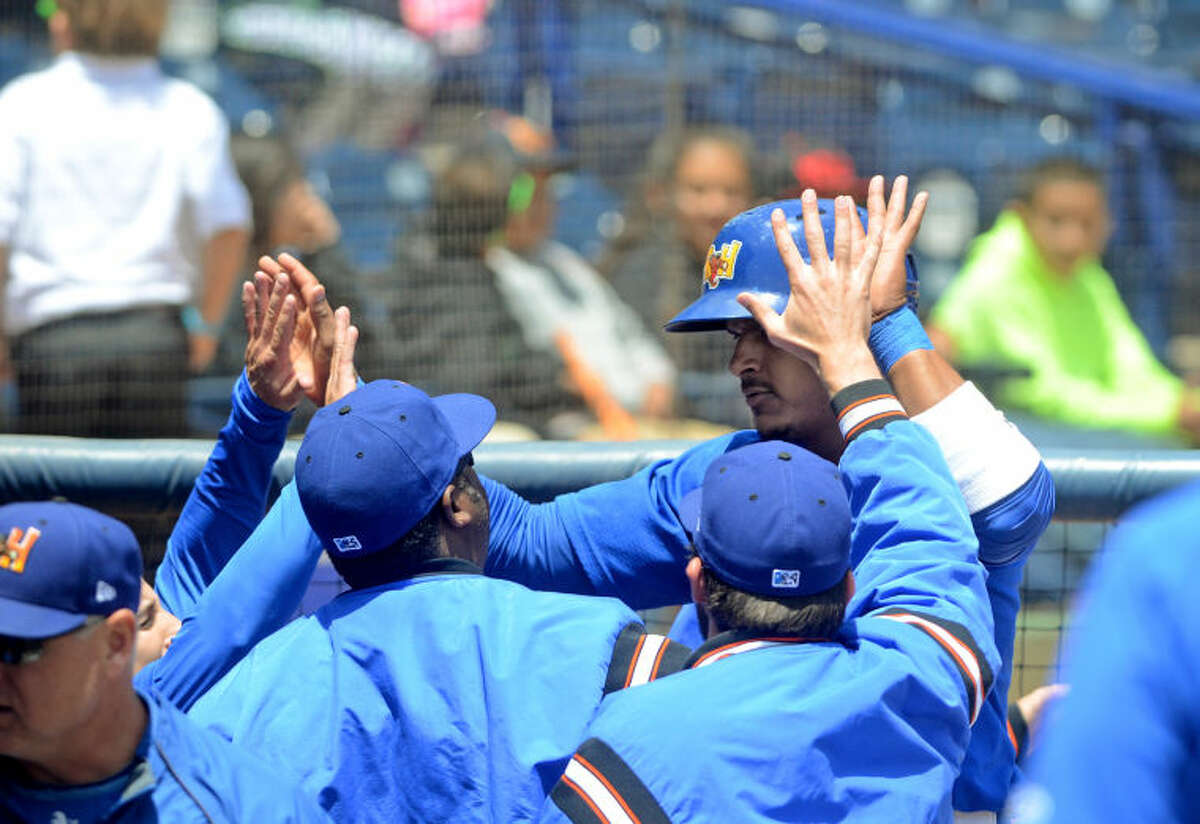 Rockhounds Jefry Marte celebrates after scoring against Corpus Christi on Wednesday at Security Bank Ballpark. Marte hit a three run double in the eighth inning to tie the game, then went on to score on a base hit for the win. James Durbin/Reporter-Telegram