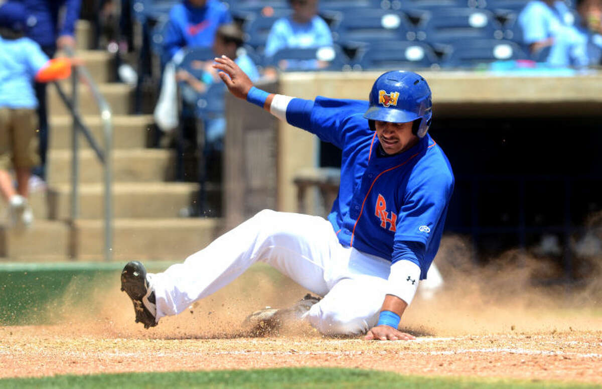 Rockhounds Jefry Marte slides home to score against Corpus Christi on Wednesday at Security Bank Ballpark. Marte hit a three run double in the eighth inning to tie the game, then went on to score on a base hit for the win. James Durbin/Reporter-Telegram
