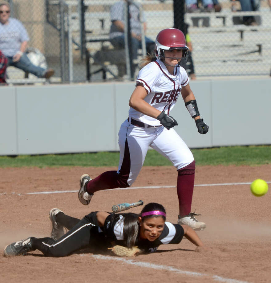 Lee's Gaby Hernandez gets a bunt past Permian's Natalia Ybarra April 19 at Gene Smith Field. James Durbin/Reporter-Telegram Photo: JAMES DURBIN