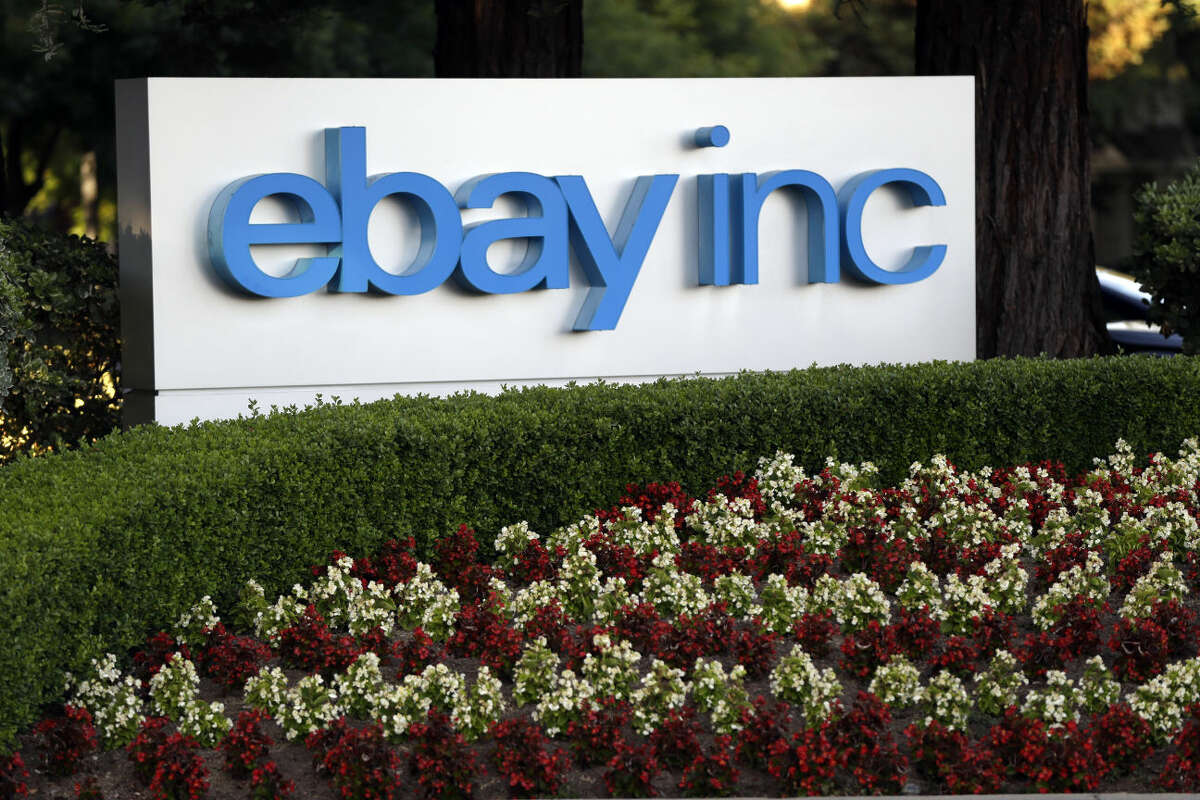 In this June 5, 2014 photo, flowers bloom in front of an eBay Inc. sign on in the company's headquarters in San Jose, Calif. Calling it a