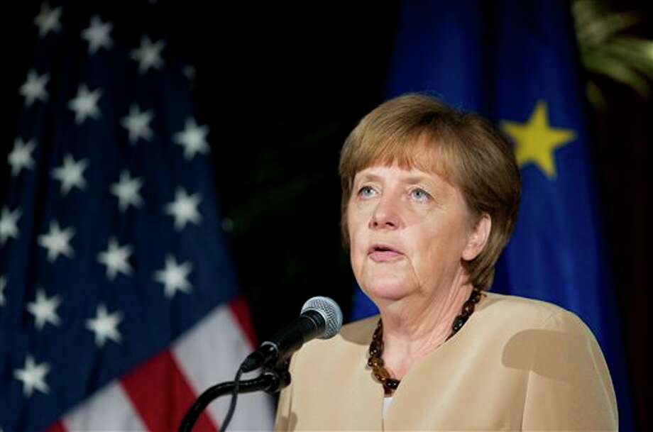 German Chancellor Angela Merkel speaks at the U.S. Chamber of Commerce in Washington, Friday, May 2, 2014. Earlier she met with President Barack Obama at the White House. (AP Photo/Manuel Balce Ceneta) Photo: Manuel Balce Ceneta / AP