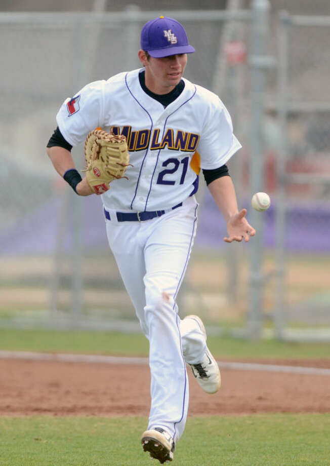 Midland High's Travis Wilbanks runs off the field after closing out the inning with an out at first base during the game against Odessa High on March 8 at Zachery Field. James Durbin/Reporter-Telegram Photo: JAMES DURBIN
