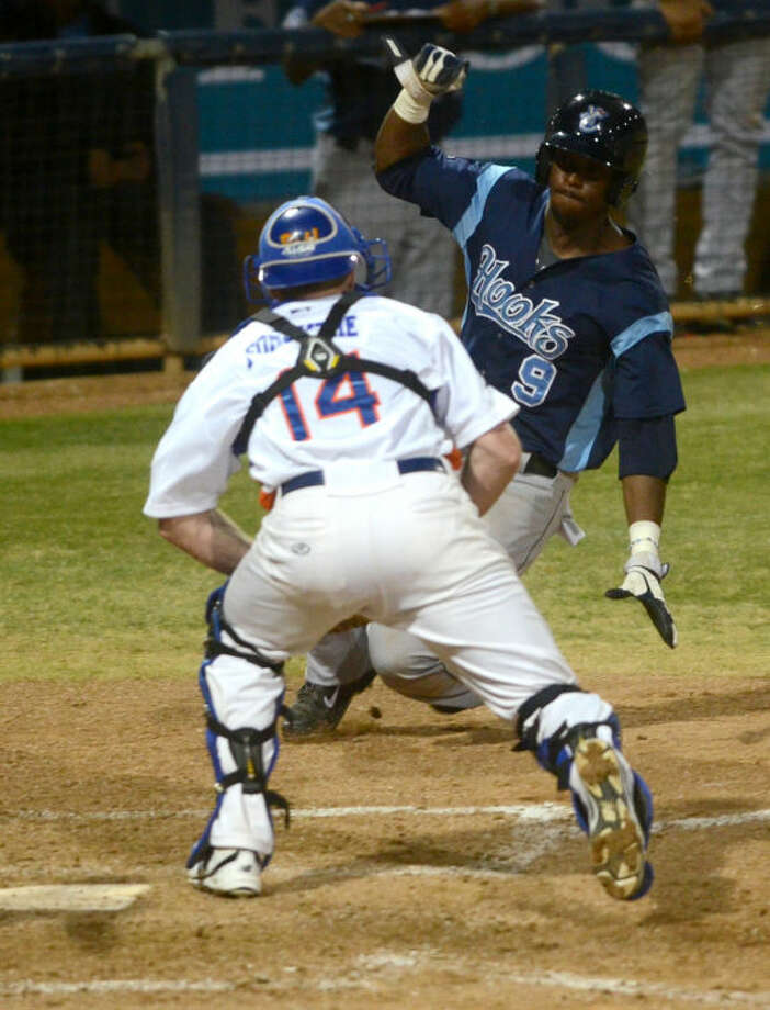 Rockhounds catcher Blake Forsythe tags out against Corpus Christi's Chris Epps at home plate Friday at Security Bank Ballpark. James Durbin/Reporter-Telegram Photo: James Durbin