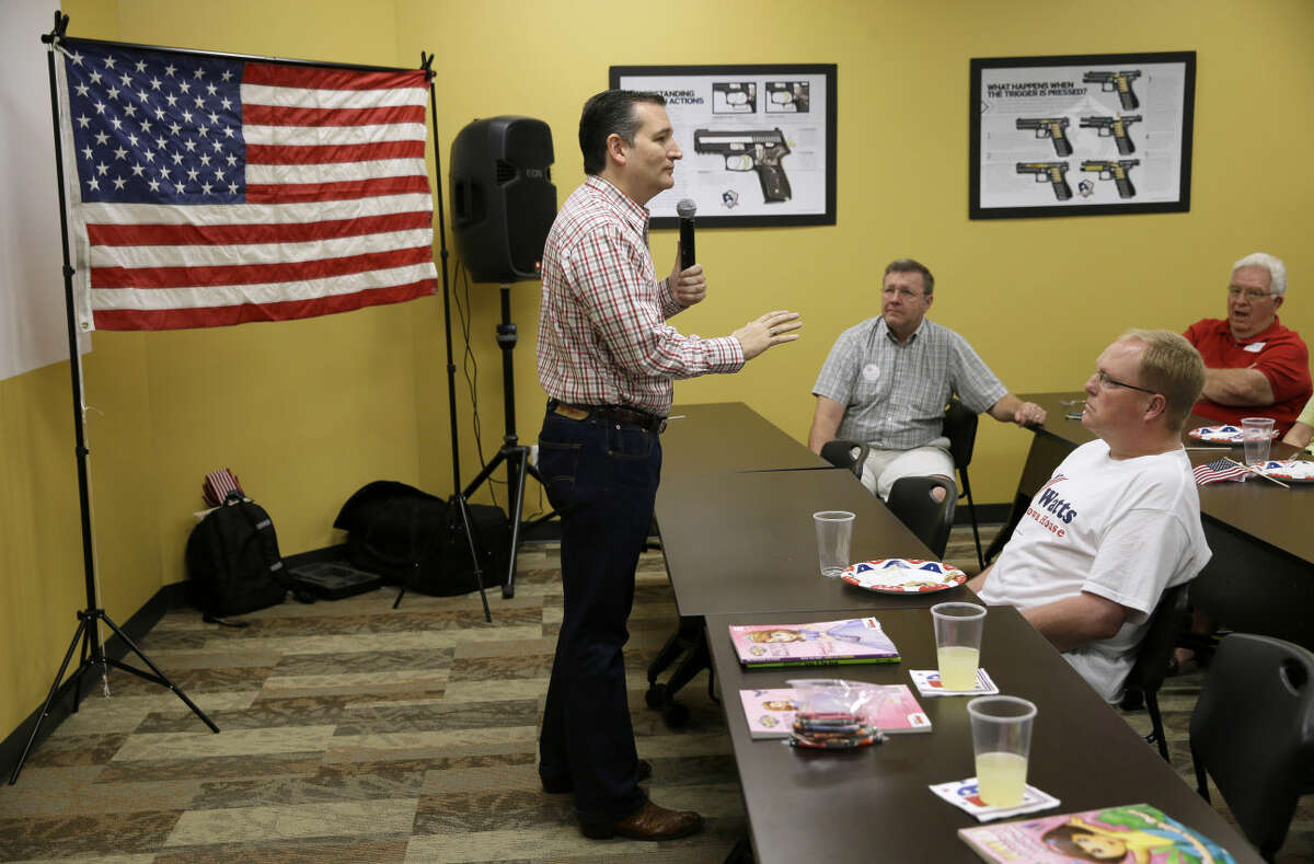 """Republican presidential candidate, Sen. Ted Cruz, R-Texas, speaks during a """"Celebrate the 2nd Amendment Event,"""" Saturday, June 20, 2015, at the CrossRoads Shooting Sports in Johnston, Iowa. (AP Photo/Charlie Neibergall)This photo of a picture of a gun pointed at Cruz's head is seen as in poor taste by many people."""