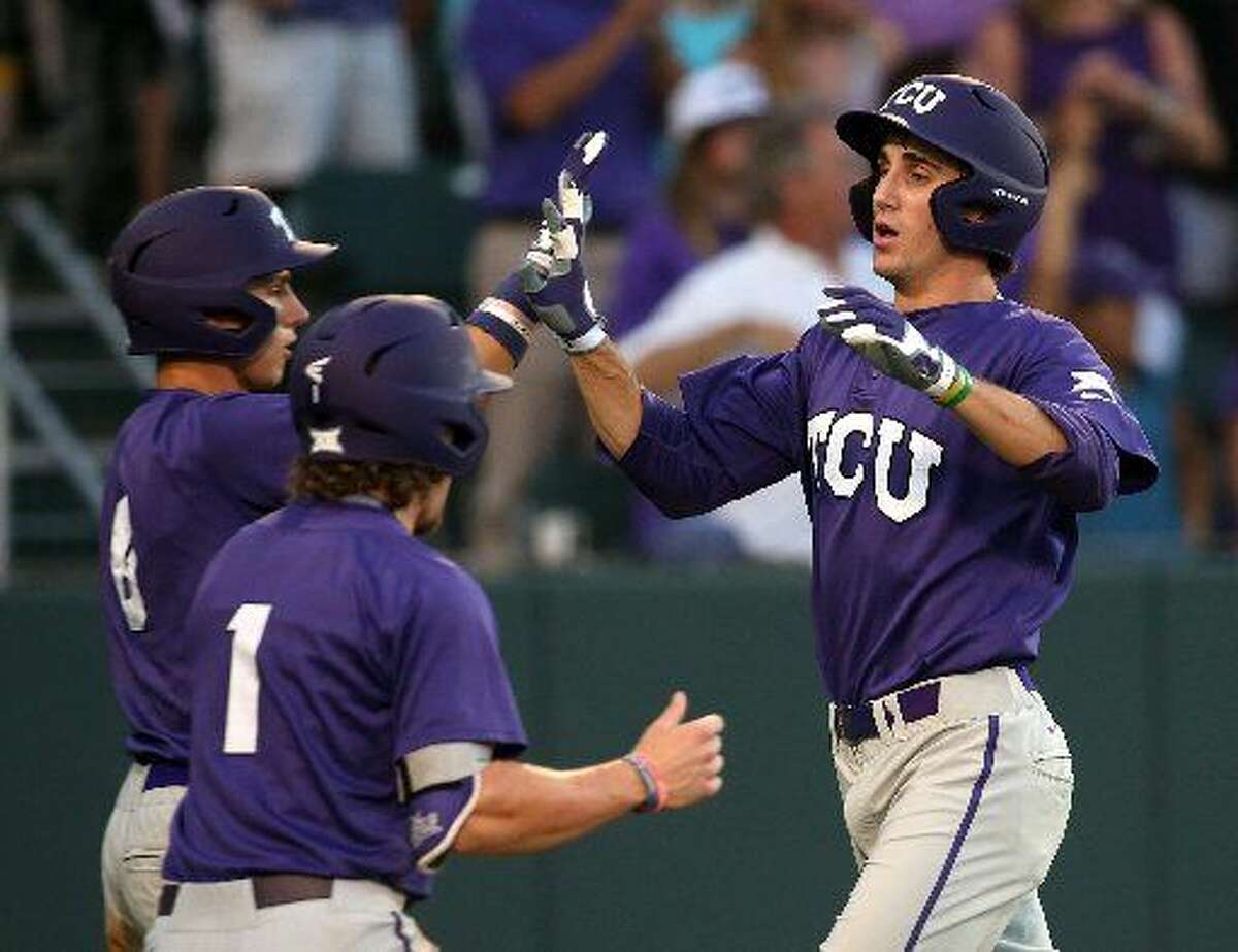 TCU's Nolan Brown (6) and Cody Jones (1) celebrate with Jeremie Fagnan, right, after scoring on a triple by Dane Steinhagen in the third inning against North Carolina State in an NCAA college baseball tournament regional game Sunday, May 31, 2015, in Fort Worth. (Richard W. Rodriguez/Fort Worth Star-Telegram via AP)