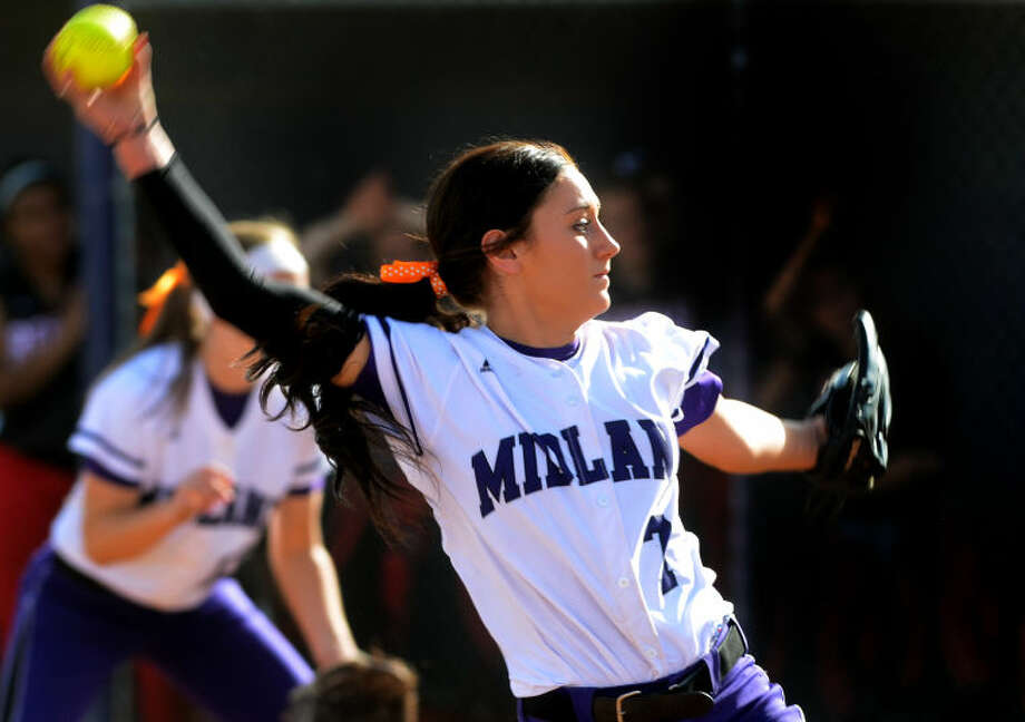 Midland High's Kendra Evans pitches against Amarillo Tascosa on Friday at Audrey Gill Sports Complex. James Durbin/Reporter-Telegram Photo: JAMES DURBIN