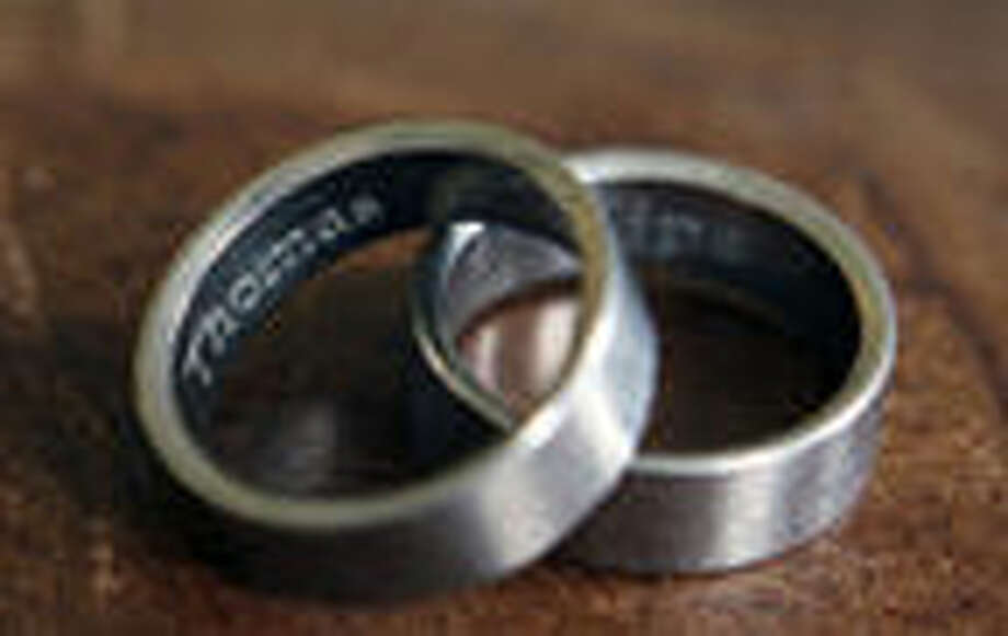 In this photo taken March 22, 2015, the rings of Thomas Kostura and Ijpe DeKoe sit on a table in their Memphis, Tenn. apartment. Nearly half of Americans favor laws allowing gay and lesbian couples to wed in their own states, while just over a third are opposed, according to an Associated Press-GfK poll in April. Photo: AP